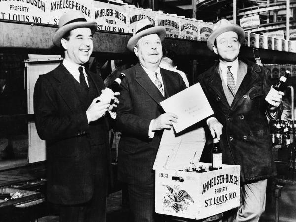 August A. Busch (center) and his sons, Adolphus III (left) and August Jr., seal the first case of beer off the Anheuser-Busch bottling plant line in St. Louis on April 7, 1933, when the sale of low-alcohol beers and wines was once again legal. Prohibition didn't officially end until Dec. 5 of that year.