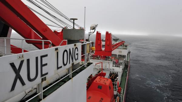 The Chinese research vessel and icebreaker Xue Long broke free from ice and was back in the open waters off Antarctica on Tuesday.
