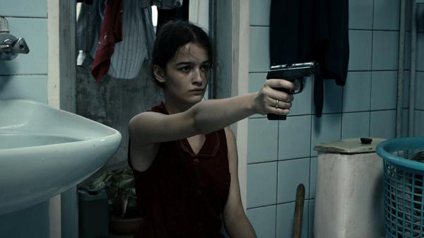 In the chaos of post-independence  Georgia, 14-year-old Natia (Mariam Bokeria) receives a present from her romantic interest — a gun — in <em>In Bloom.</em>