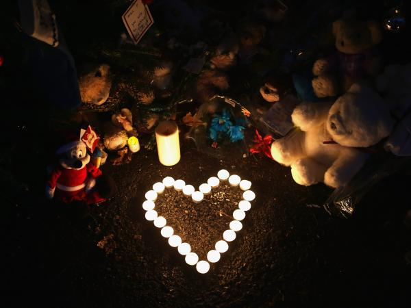 Newtown, Conn., Dec. 20, 2012: Stuffed animals and a candle arrangement at a streetside memorial for the 20 children and six adults killed at Sandy Hook Elementary School.