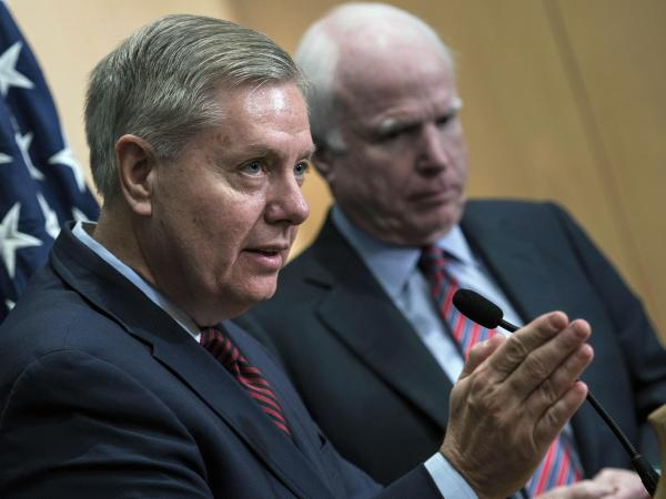 Senators Lindsey Graham and John McCain say President Obama's total withdrawal of U.S. troops from Iraq is to blame for the surge in violence for al-Qaida there.
