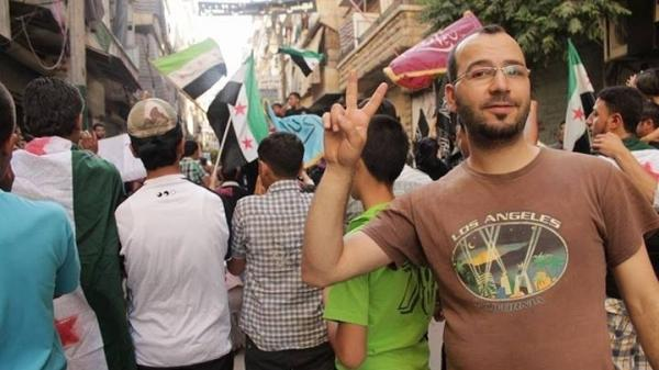 Kotaiba Mohammad poses during an anti-goverment demonstration in the northern Syrian city of Aleppo. He worked as a nurse, helping those wounded in the country's civil war. He was seized and shot dead last month by Islamic extremists.