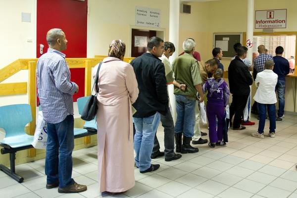 Syrian refugees arriving at the transit camp in Friedland, Germany, stand in line at the registration desk on Sept. 11. Germany has deported asylum seekers on the basis of an EU treaty that requires migrants seeking entry to Europe to be processed by the first EU country they arrive in. Many Syrians in Germany have come from other countries such as Bulgaria or Greece.