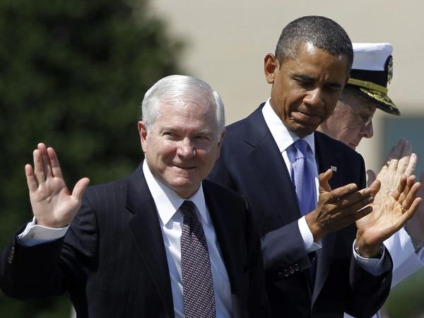 Robert Gates waves and President Obama claps at the then-defense secretary's farewell ceremony in June 2011.