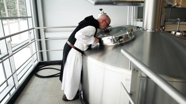 A monk at St. Joseph's Abbey inspects the boil.