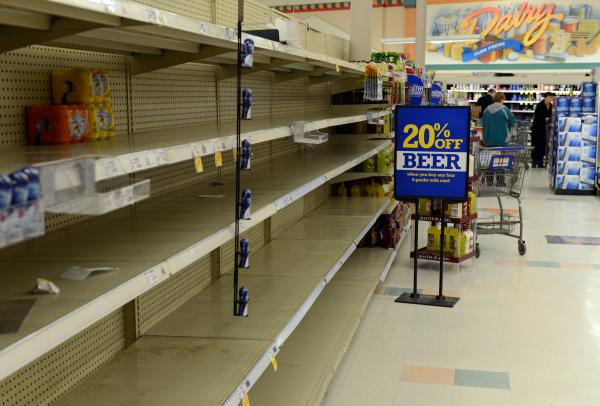 Shelves at Krogers remain empty after running out of water in Kanawha City a neighborhood of Charleston on Friday.