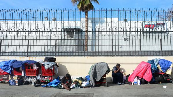 Homeless women sit amid their belongings in downtown Los Angeles on Wednesday. Democrats and Republicans say income inequality is a problem, but they disagree over a solution.