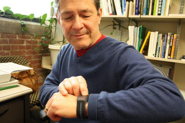 Criminal justice professor Bryan Vila wears an actigraph, a movement-monitoring device. The BeSharp app uses data from the device to determine alertness.