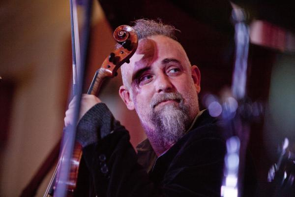 Mat Maneri played viola in the trio led by drummer Ches Smith.
