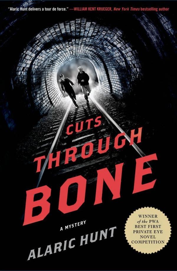 <em>Cuts Through Bone</em>, by Alaric Hunt, is published by Minotaur/Thomas Dunne Books.