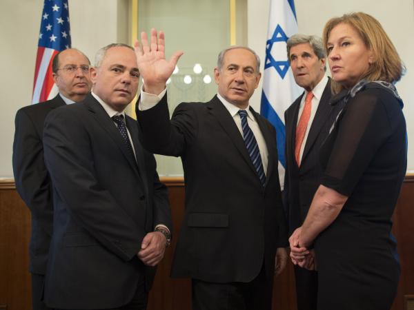 U.S. Secretary of State John Kerry, second right, stands with Israeli Defense Minister Moshe Yaalon, left, Minister of International Relations Yuval Steinitz, second left, Israeli Prime Minister Benjamin Netanyahu, center, and Minister of Justice Tzipi Livni at Netanyahu's office on May 23, 2013, in Jerusalem.