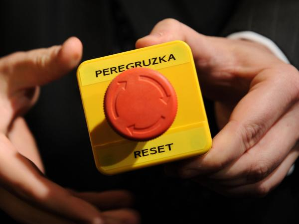 "An assistant shows the block with a red button marked ""reset"" in English and ""overload"" in Russian that U.S. Secretary of State Hillary Clinton handed to Russian Foreign Minister Sergei Lavrov during a 2009 meeting in Geneva."