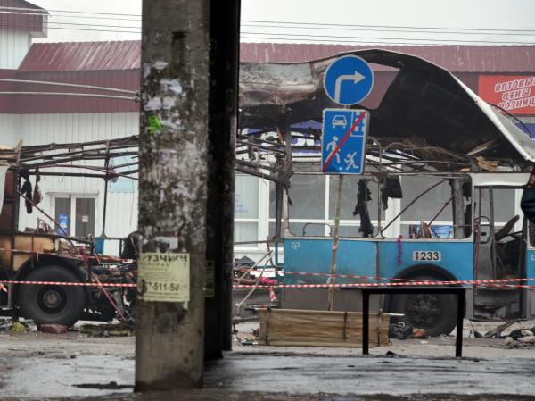 A pair of suicide bombings in the city of Volgograd — about 400 miles from Sochi — left 34 people dead and dozens wounded. Here, a destroyed trolley bus sits on a street in Volgograd on Dec. 30.