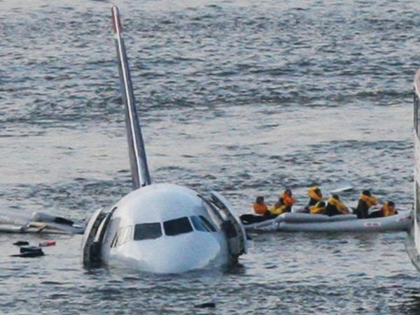 "Jan. 15, 2009: As the U.S. Airways jet they had been on sinks into the Hudson River, passengers are rowed away. This isn't <a href=""https://twitter.com/jkrums/status/423458459737419777"">the iconic (and now copyrighted) photo</a> that helped transform Twitter. But it does give a sense of what it was like that day, 5 years ago."