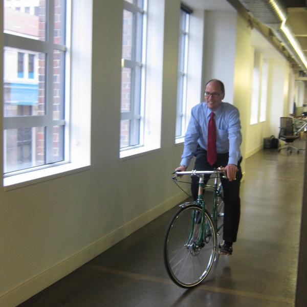 Perez bikes in the offices of Shinola, a company that manufactures high-end watches and bicycles.