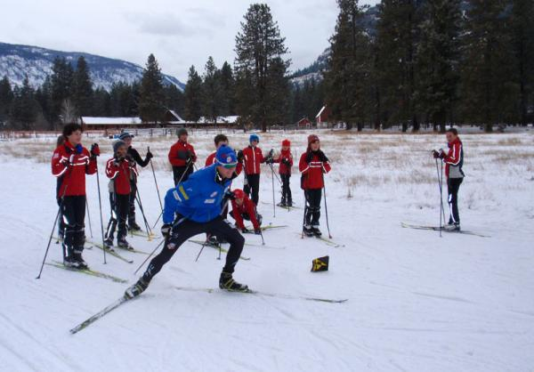 Olympic hopeful Erik Bjornsen demonstrates racing technique at a kids ski clinic in Mazama, Wash.