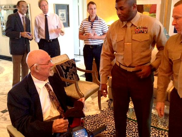 "Earlier this month, Hal Faulkner (left), 79, received his new papers from two Marines after having his military status changed to ""honorable discharge."" Faulkner died Tuesday."