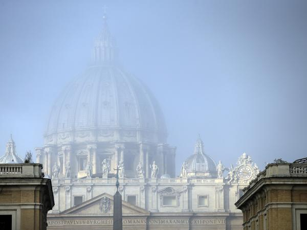 A light fog engulfs St. Peter's Basilica's dome at the Vatican on Saturday. The Vatican came in for tough public scrutiny over its handling of the clergy sex abuse scandal at a U.N. hearing in Geneva on Thursday.