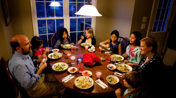 "Americans are dining out less and eating at home more, new government research shows. This may mean more <a href=""http://www.npr.org/blogs/thesalt/2013/02/26/172897660/family-dinner-treasured-tradition-or-bygone-ideal"">family dinners</a>, like this one at the Brown-Spencer home in Mechanicsville, Va."