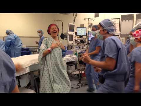 Dr. Deborah Cohan dances to Beyoncé with OR staff as she prepares to receive a double mastectomy. The video went viral, getting over seven million hits on YouTube. Cohan recently started chemotherapy. (Photo credit: YouTube)