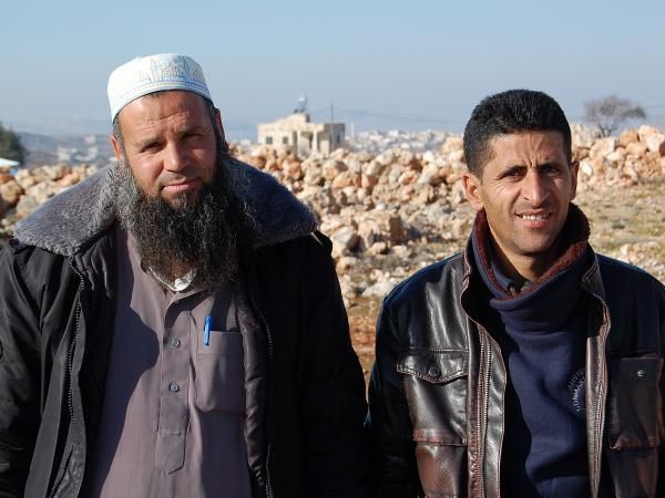 Ziad Oday (left), a village council member and imam in Qusra, and Abdel Wadi, Qusra village council head, intervened in the recent clash between Jewish settlers and angry Palestinians. They're shown here on a hill in Qusra.