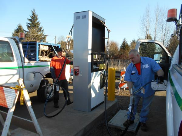 NW Natural employees at its Sherwood yard fill company service trucks that run on natural gas.