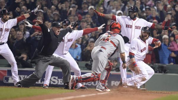 Upon further review ... Boston Red Sox baserunner Jonny Gomes, right, would still be safe at home during last fall's World Series.