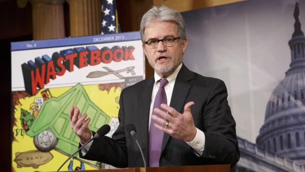 "Sen. Tom Coburn, R-Okla., outlines his annual ""Wastebook,"" which points a critical finger at billions of dollars in questionable government spending, on Dec. 17 on Capitol Hill."