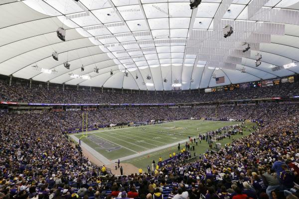 Fans cheer on Dec. 29, during the last NFL football game ever played at the Metrodome in Minneapolis.