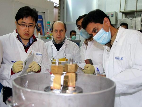 An IAEA team checks the enrichment process inside the uranium enrichment plant Natanz in central Iran on Monday.