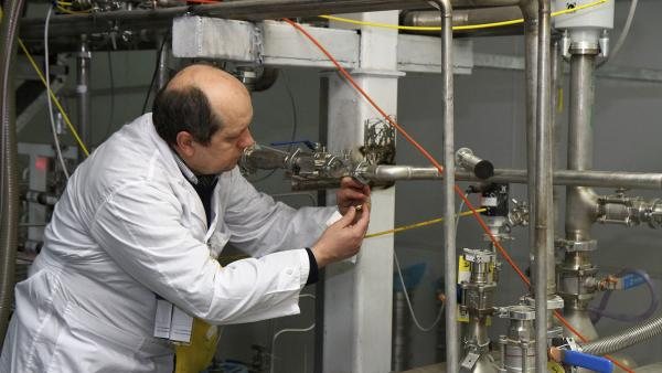 An unidentified inspector from the International Atomic Energy Agency examines equipment at the Natanz facility in Iran on Monday.