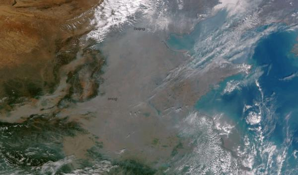 A satellite image of smog over China. Westerly winds can carry air pollution from China across the Pacific Ocean in just a few days. A new study is linking air pollution in the Western United States to China's booming exports.