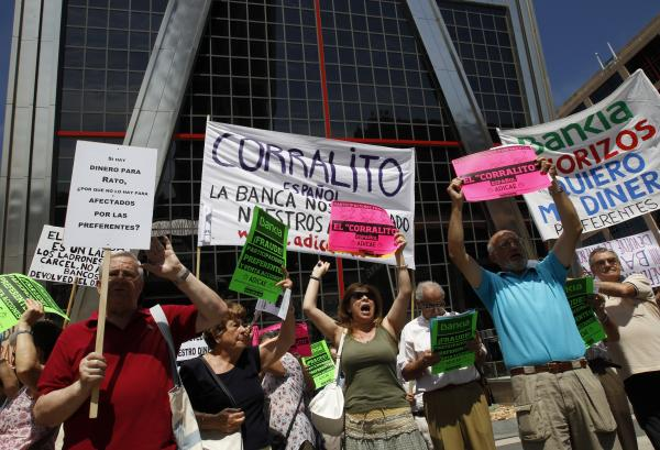 Shareholders protest bank practices at the headquarters of Spain's largest mortgage lender, Bankia, in Madrid on June 23, 2012, at the height of the country's banking crisis. Europe stepped in at that time with $56 billion in loans to help the banking system.