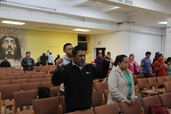 Worshippers are brought to tears at the Wednesday night Charismatic prayer meetings at St. Anthony of Padua Catholic Church in the Bronx, New York City.