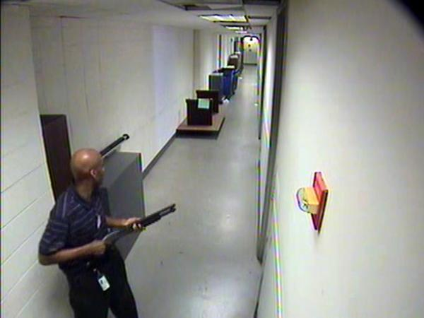 Surveillance camera video of Aaron Alexis, a contractor who killed 12 people at the Washington Navy Yard on Sept. 16, 2013. Alexis was one of thousands of individuals cleared by the firm known as USIS.