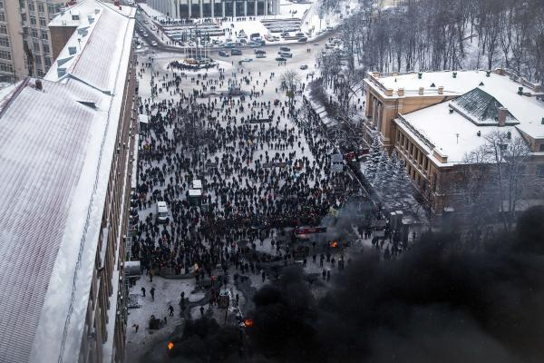 Clashes raged in the center of the Ukrainian capital as protesters hurled stones and Molotov cocktails at police; the security forces responded with tear gas, stun grenades and rubber bullets.