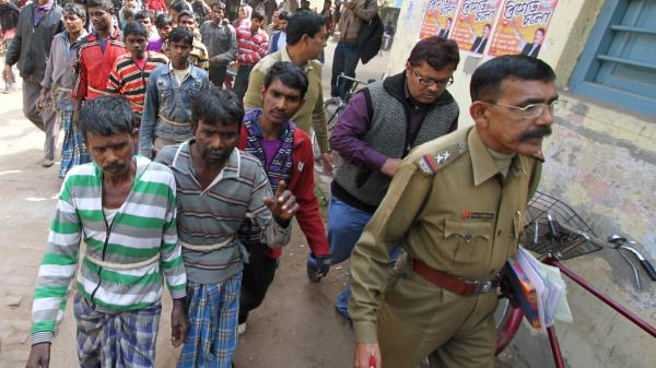 Police lead suspects in a gang rape case to a courthouse near the eastern Indian village of Subalpur on Thursday. A 20-year-old woman was allegedly gang raped on orders from tribal elders who objected to her relationship with a man outside her community.