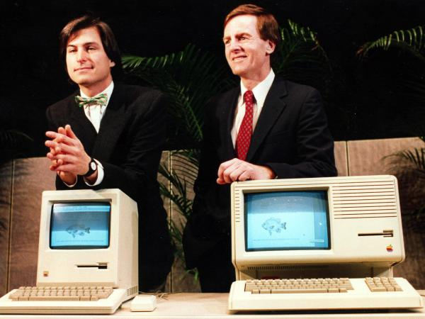 Apple's CEO Steve Jobs (left) and President John Sculley display the hardware unveiled at the annual shareholders meeting on Jan. 24, 1984.