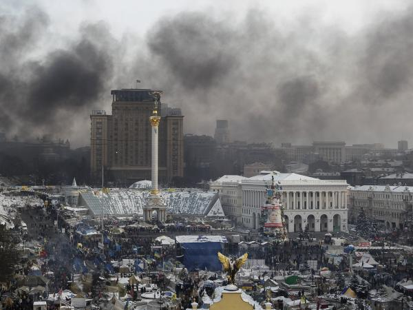 Smoke rises from Independence Square in Kiev, where anti-government protesters are rallying on Saturday.