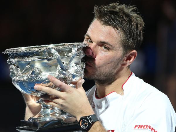 Stanislas Wawrinka of Switzerland kisses the Australian Open trophy during the awarding ceremony after winning the men's singles final against Spain's Rafael Nadal on Sunday in Melbourne, Australia.