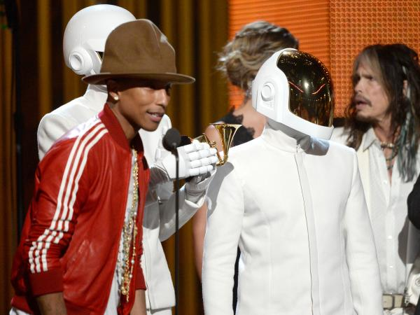 "Pharrell Williams, with Thomas Bangalter and Guy-Manuel De Homem-Christo of Daft Punk, accepts the Record of the Year award for ""Get Lucky."""