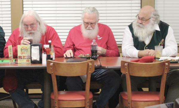 Santas eat before meeting begins. (Eric Mennel/WUNC)