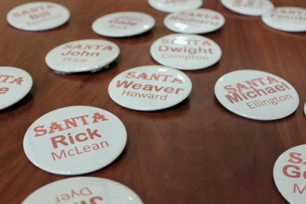 Nametags at the Triangle Santa Buddies monthly meeting. (Eric Mennel/WUNC)