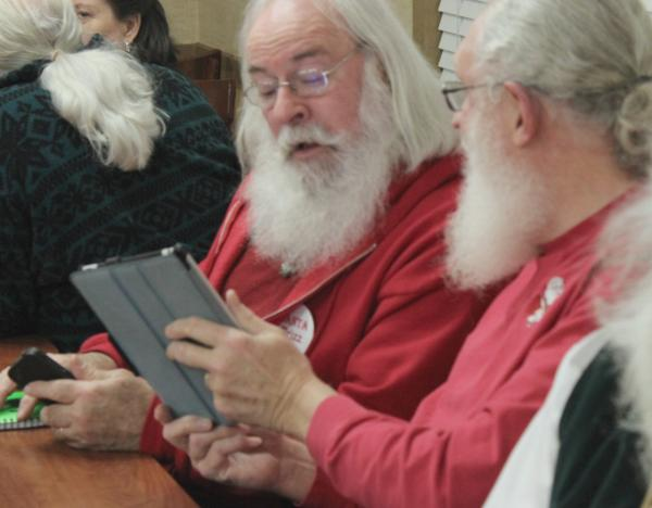 Even Santas use iPads. (Eric Mennel/WUNC)