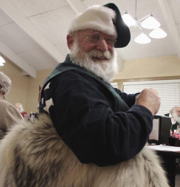 Santa Jim Dwyer spends the season working as a Mall Santa. (Eric Mennel/WUNC)