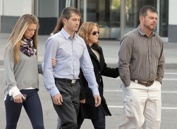 Eric Jensen, right and Ryan Jensen, brothers who owned and operated Jensen Farms, arrive at the federal courthouse in Denver in January of 2014.