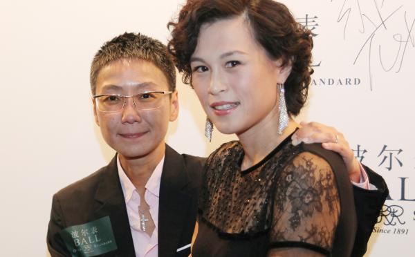 Gigi Chao (right) daughter of Hong Kong property tycoon Cecil Chao, poses with her partner, Sean Eav, at an event in Hong Kong.