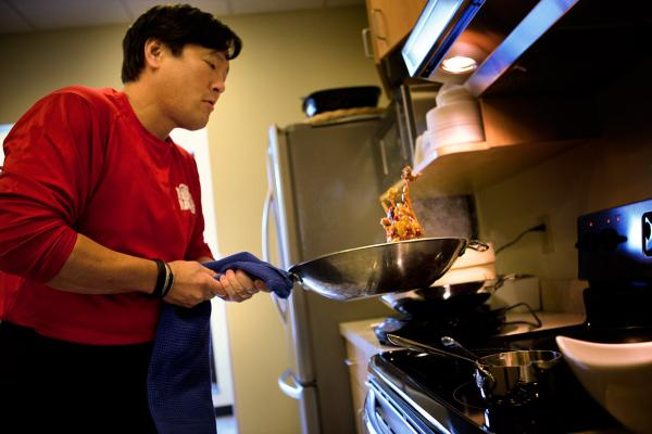 Chef Ming Tsai prepares food in the Here & Now kitchen. (Jesse Costa/Here & Now)