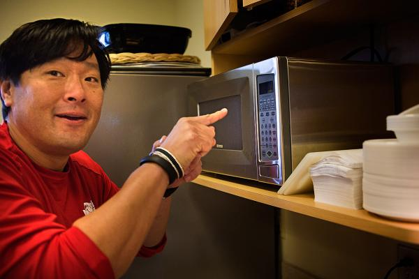 "Chef Ming Tsai demonstrates his ""secret technique"" for using a microwave. (He uses the popcorn button!) (Jesse Costa/Here & Now)"