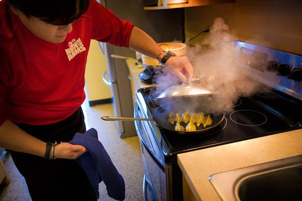 Chef Ming Tsai prepares potstickers in the Here & Now kitchen. (Jesse Costa/Here & Now)